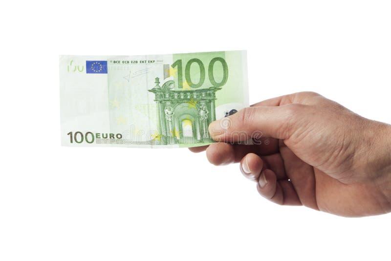 拿着一百张欧元票据的手 免版税库存照片