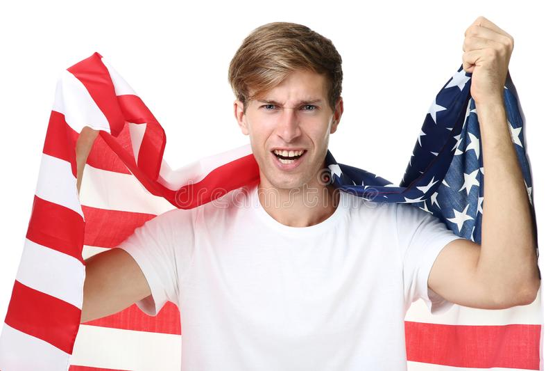 拿着一面美国国旗的年轻人 库存照片