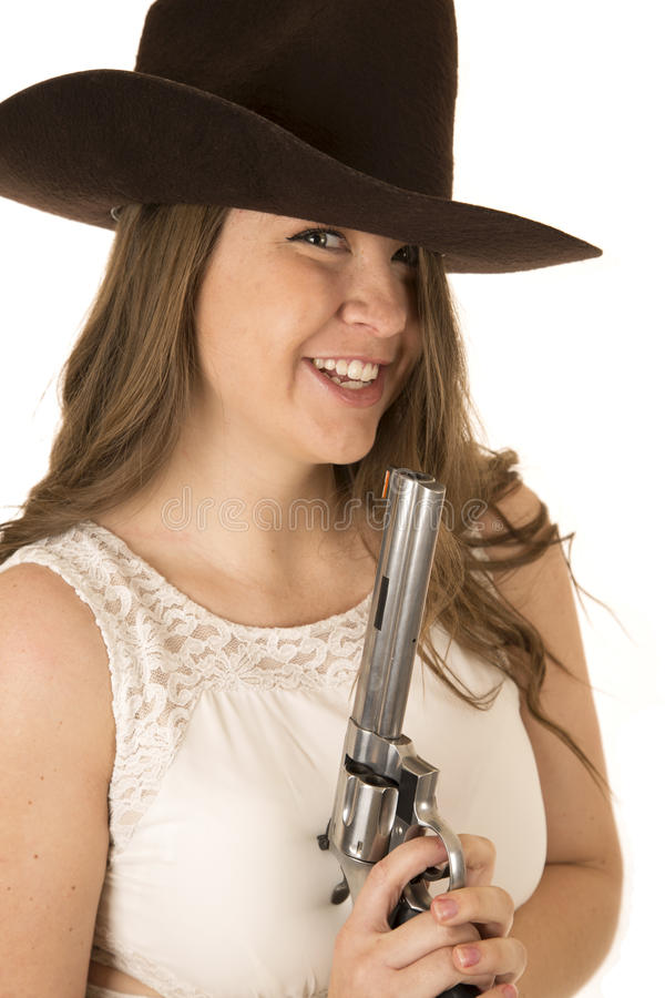 拿着与一个傻的表情的女牛仔一把大左轮手枪 库存图片