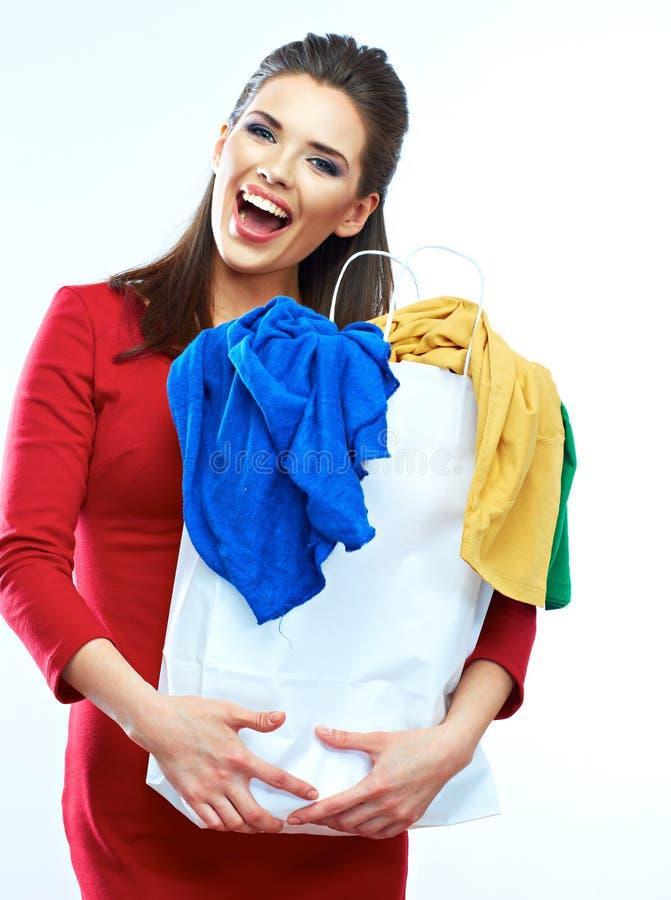 拿着与分类的红色礼服的美丽的少妇购物袋 库存图片