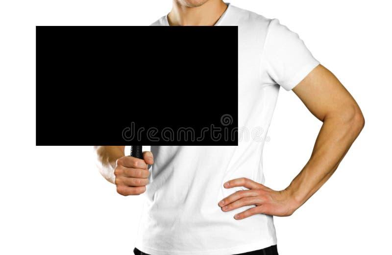 拿着与把柄的人纸板标志 关闭 被隔绝的背景 免版税图库摄影