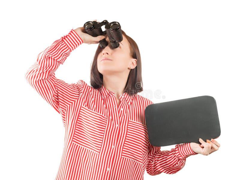 拿着与拷贝空间的妇女空白石板看通过双眼被隔绝 免版税库存图片