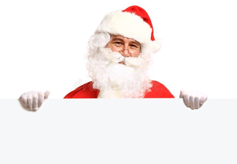拿着与空间的圣诞老人横幅文本的 免版税库存照片