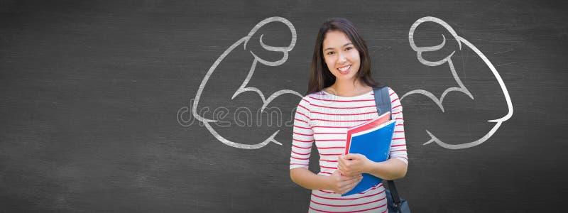 拿着与被弄脏的学生的女大学生的综合图象书在公园 免版税库存照片