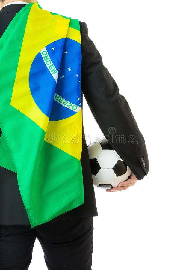 拿着与巴西旗子的亚裔商人足球 免版税库存照片