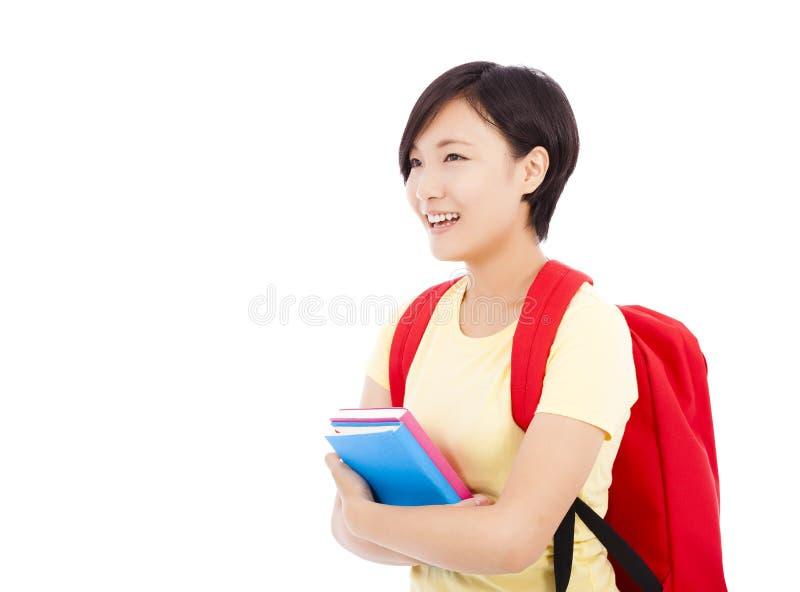 拿着书有白色背景的年轻女学生 库存照片