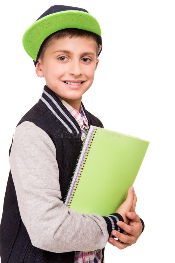 拿着书的小学生 图库摄影