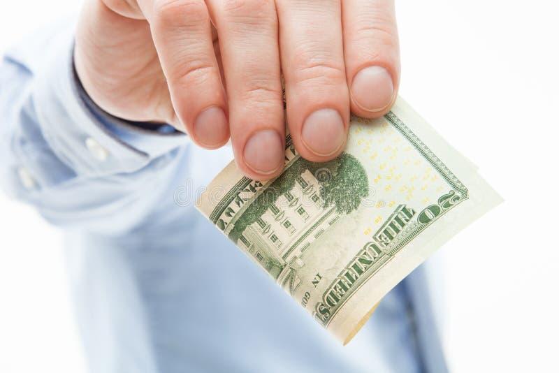 拿着二十美元的无法认出的商人 免版税库存图片