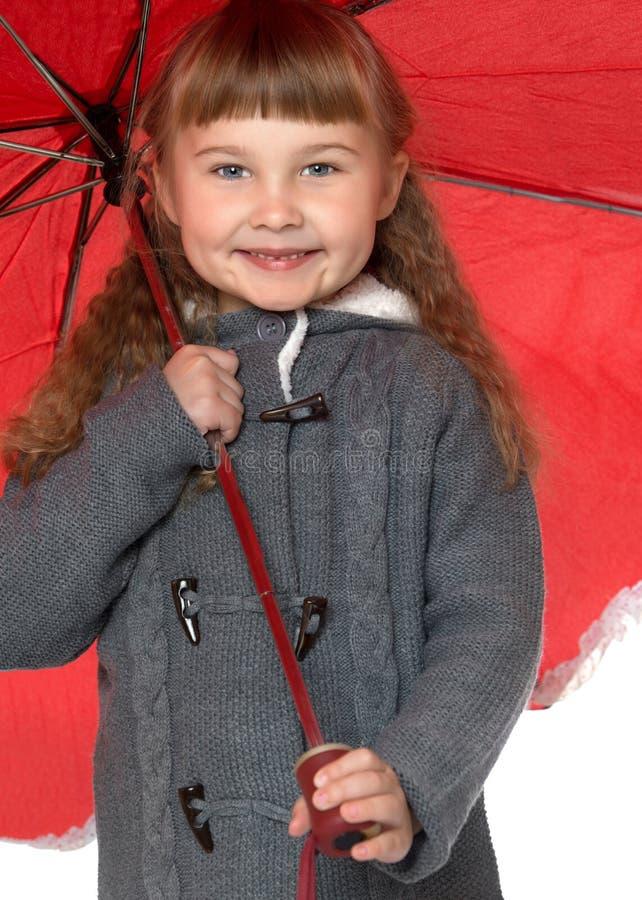 拿着伞的女孩 免版税库存照片