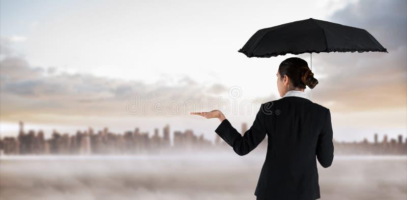 拿着伞的年轻女实业家的综合图象 库存图片