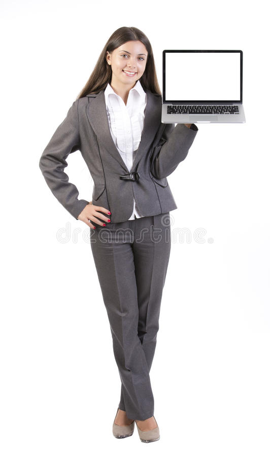 拿着便携式计算机的女商人 免版税库存照片