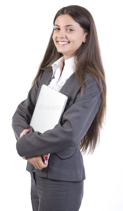 拿着便携式计算机的女商人 免版税图库摄影