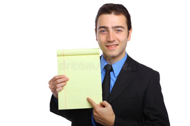 拿着便笺簿的生意人新 免版税库存图片