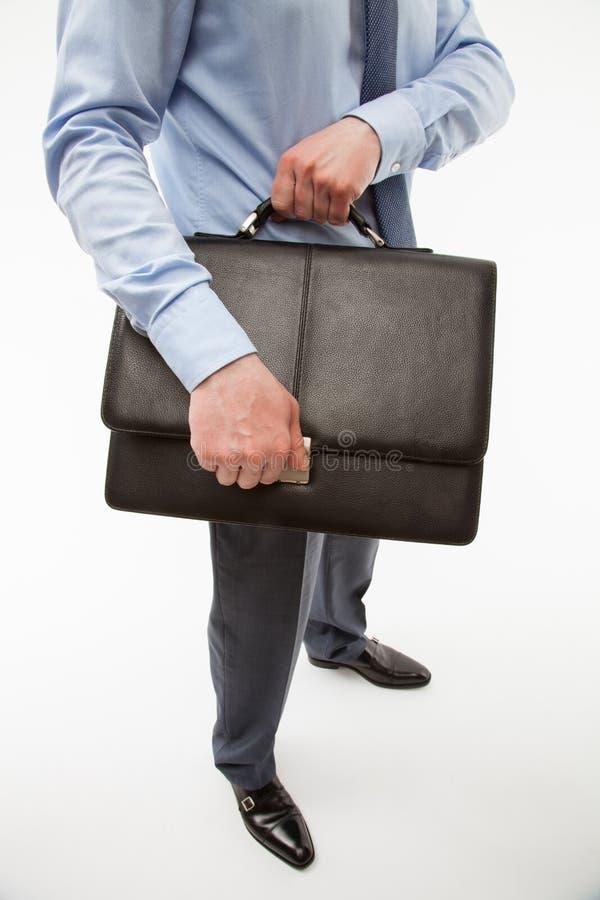拿着公文包的无法认出的商人 免版税库存图片