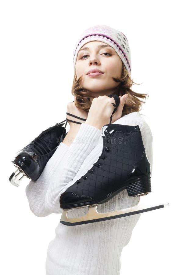 拿着冰正冰鞋妇女 图库摄影