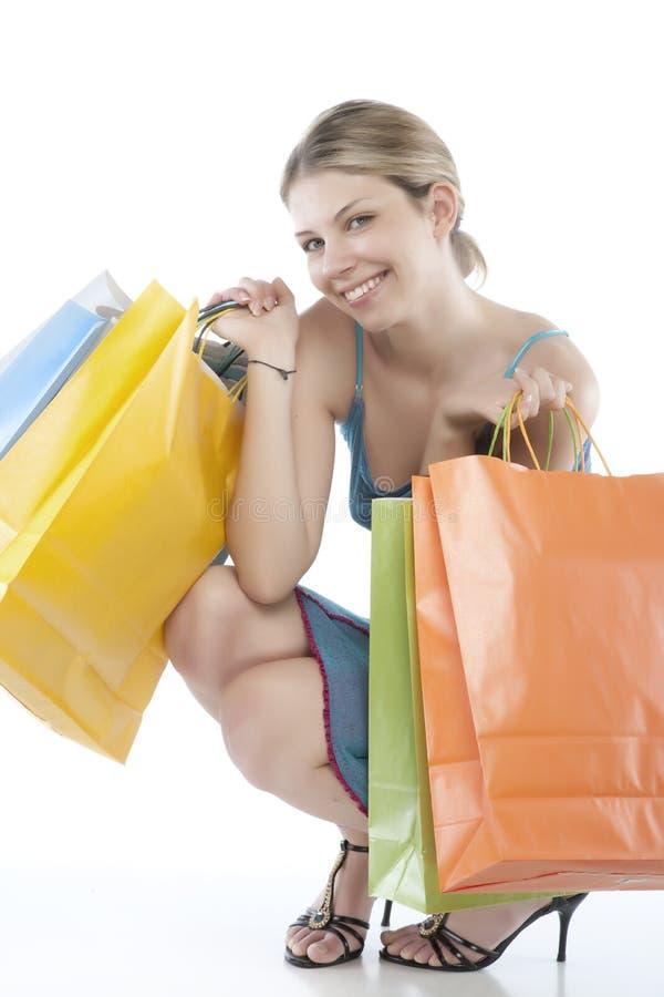 拿着几shoppingbags妇女新 库存图片