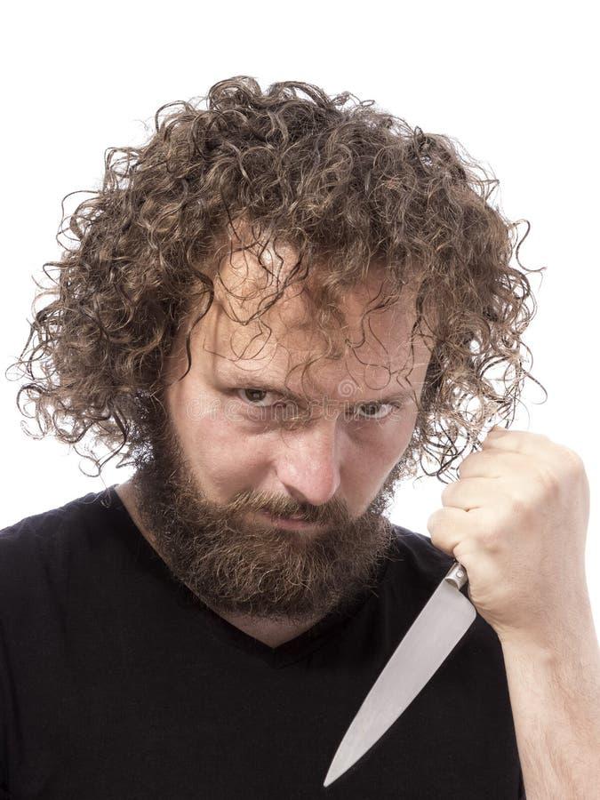 拿着刀子画象的有胡子的人 免版税库存照片
