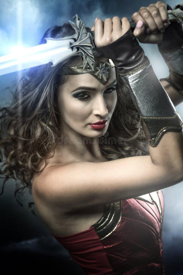 拿着剑的美好的超级英雄 图库摄影