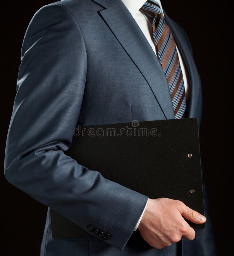 拿着剪贴板的商人 库存图片