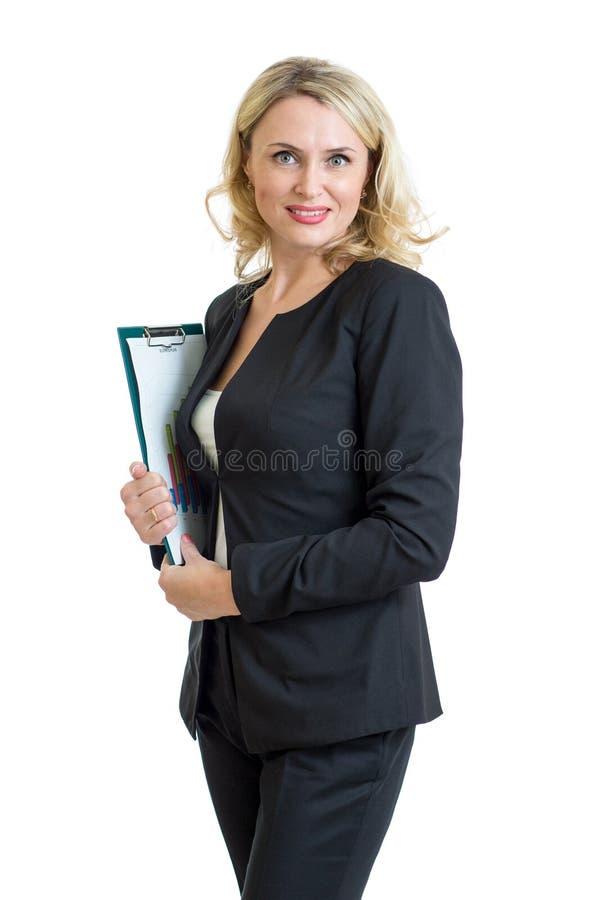 拿着剪贴板的微笑的女商人被隔绝 免版税库存照片
