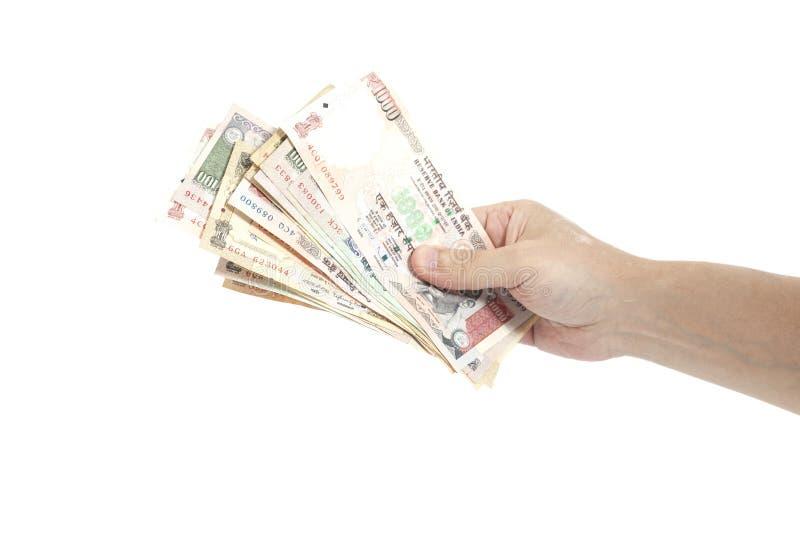 拿着印地安人的手一千卢比笔记 免版税库存图片