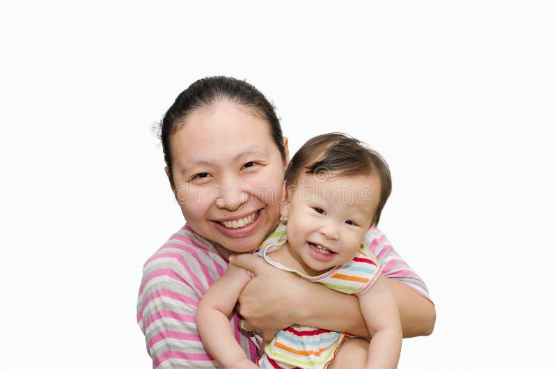 拿着可爱的儿童女婴的亚裔母亲 库存图片