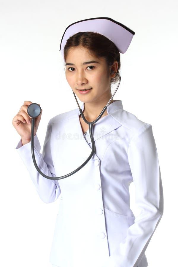 拿着听诊器的护士 免版税库存照片