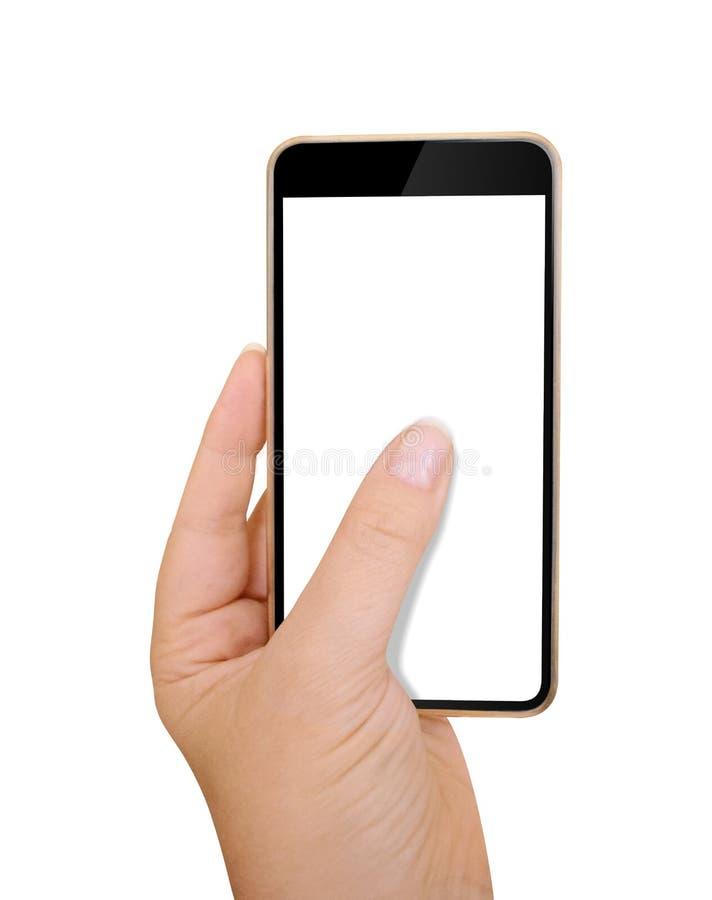 拿着和接触有白色屏幕的被隔绝的女性手一个黑电话 免版税库存照片