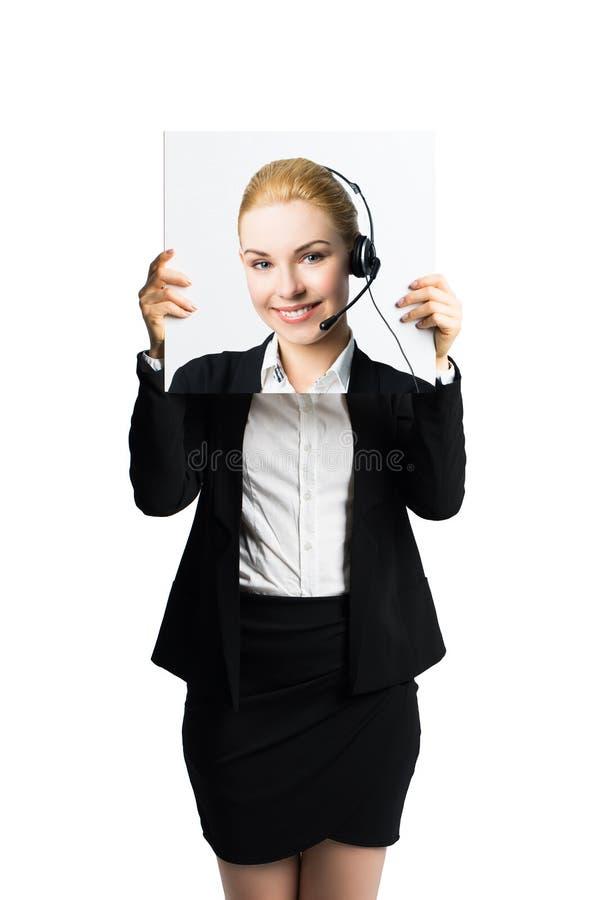拿着图片的她自己的女实业家,显示积极态度作为门面 库存照片
