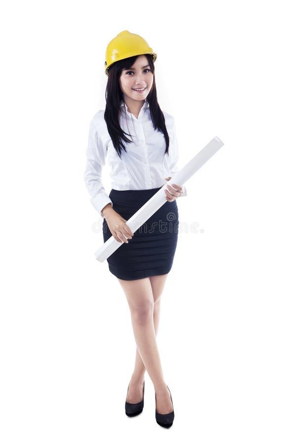 拿着图纸的亚裔女性建筑师-被隔绝 图库摄影
