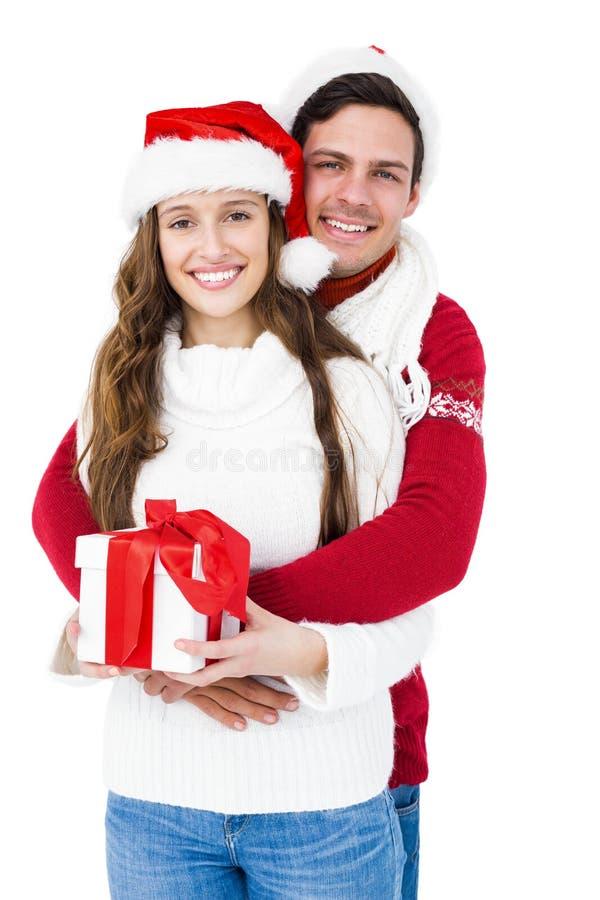 拿着圣诞节礼物的欢乐夫妇 库存图片