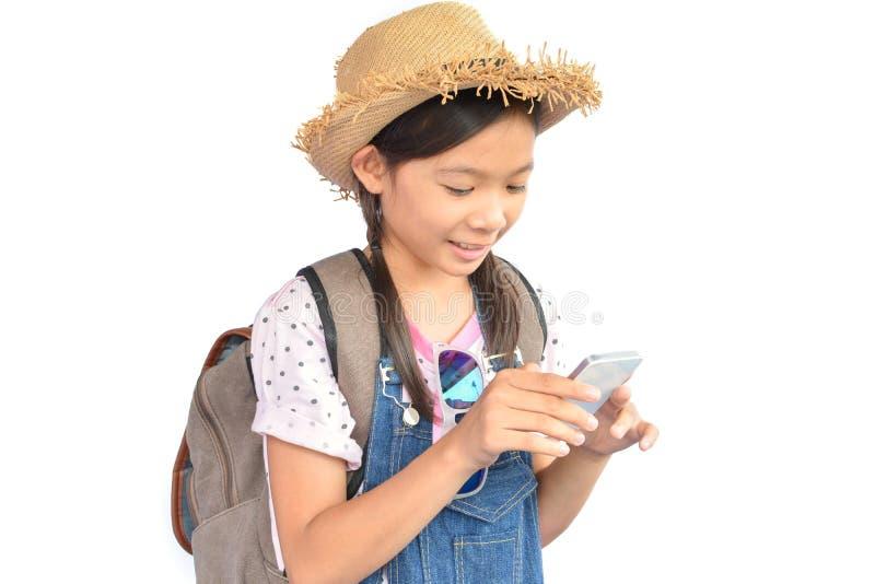 拿着在白色的小亚裔女孩画象智能手机 库存照片