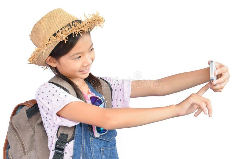 拿着在白色的小亚裔女孩画象智能手机 库存图片