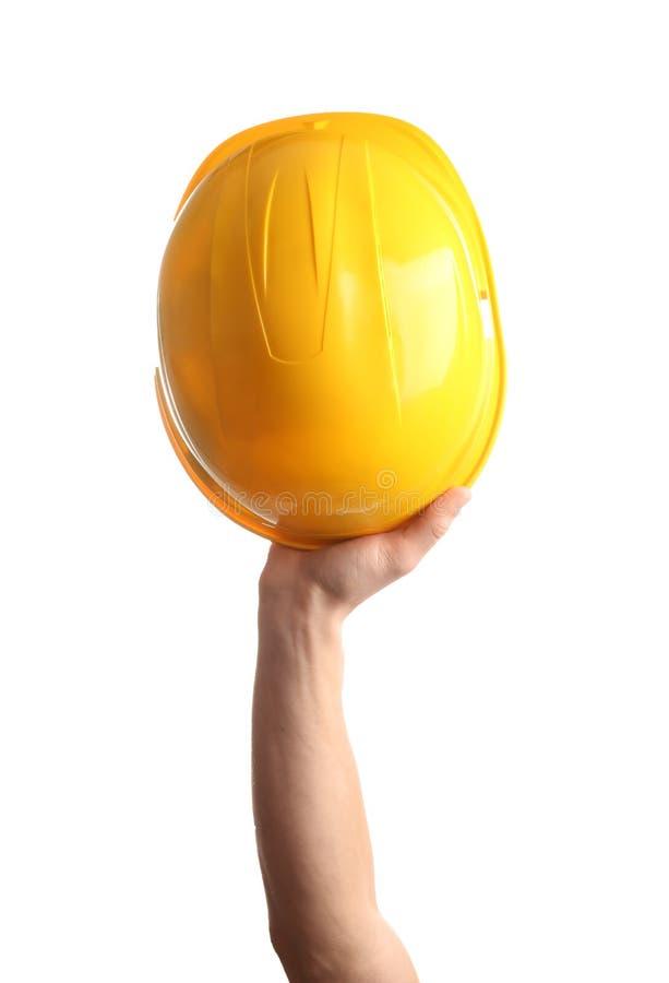 拿着在白色的建筑工人安全帽 库存照片