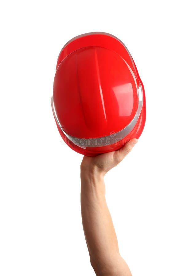 拿着在白色的建筑工人安全帽 图库摄影