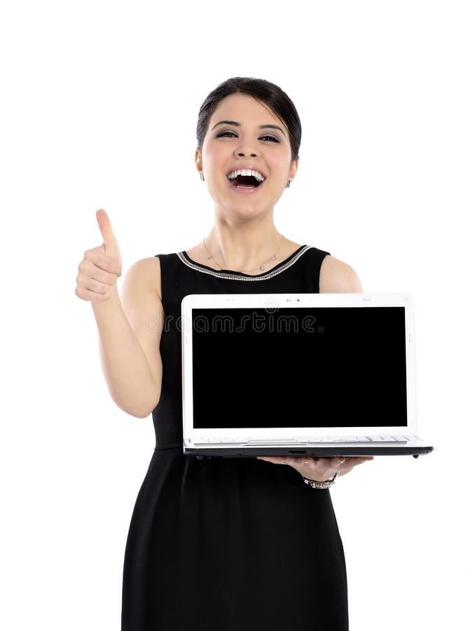 拿着在白色的愉快的女商人一台膝上型计算机 库存照片