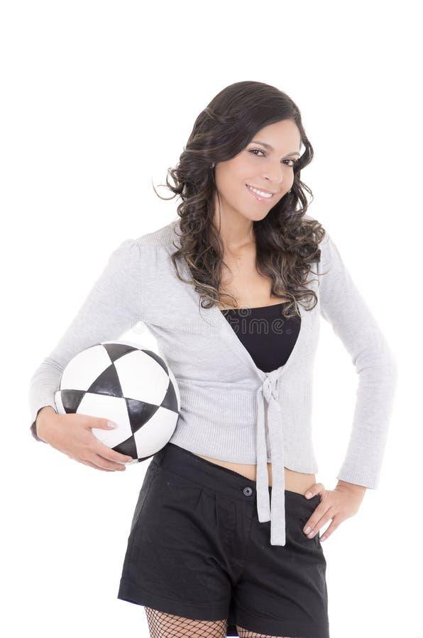 拿着在白色的欢呼的少妇足球 免版税库存图片