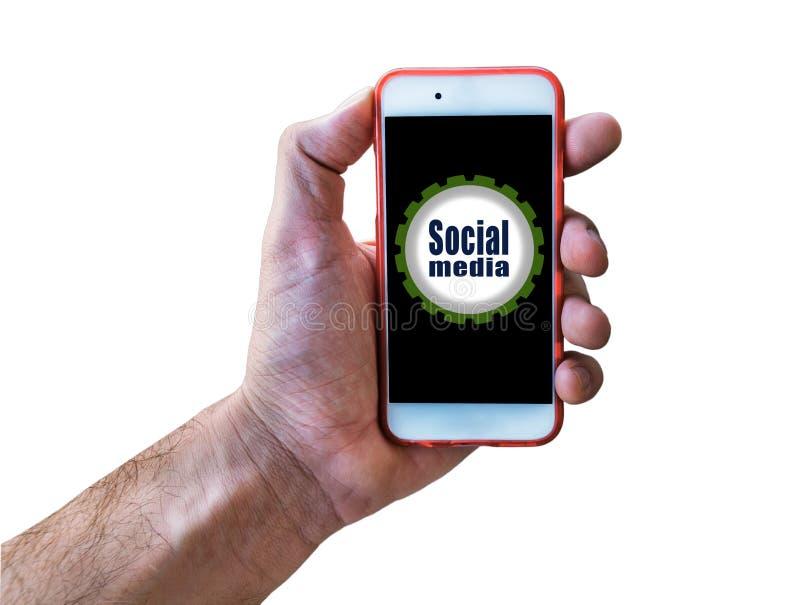 拿着在白色的社会媒介营销概念手流动孤立 免版税库存图片