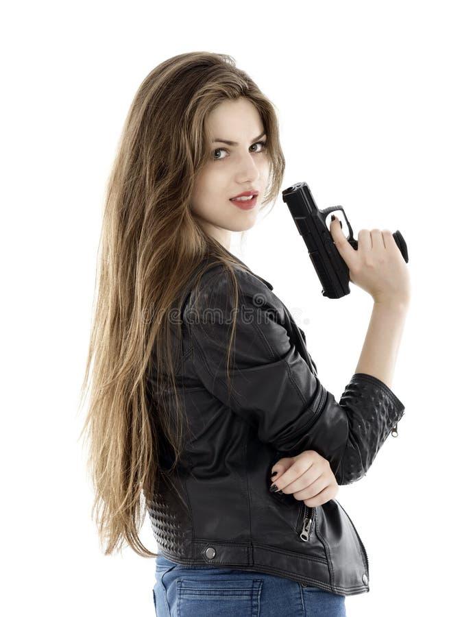 拿着在白色背景的美丽的妇女一杆枪 库存图片