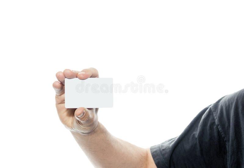拿着在空白的背景的人名片 免版税图库摄影