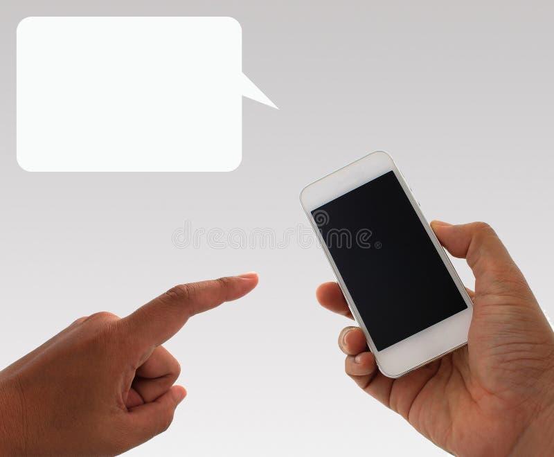 拿着在背景的手智能手机 库存图片