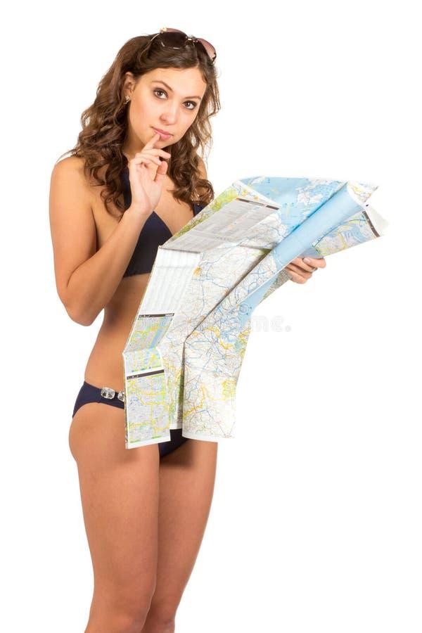 拿着地图的愉快的妇女-被隔绝在白色背景 库存图片