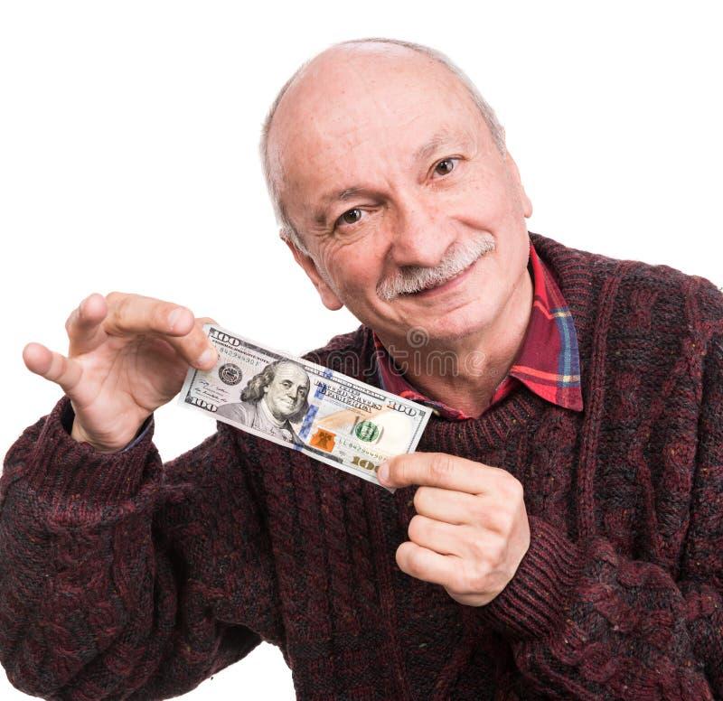 拿着堆金钱的老人 一个激动的老商人的画象 库存照片