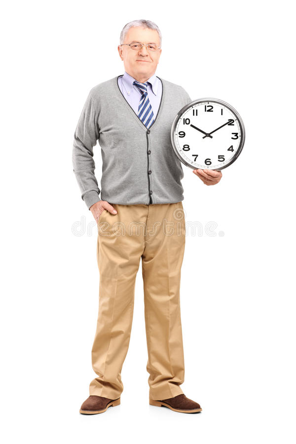 拿着壁钟的绅士的全长纵向 图库摄影