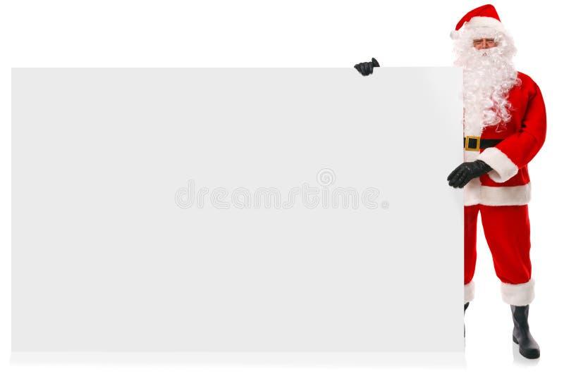 拿着大空白符号的全长圣诞老人 免版税库存图片