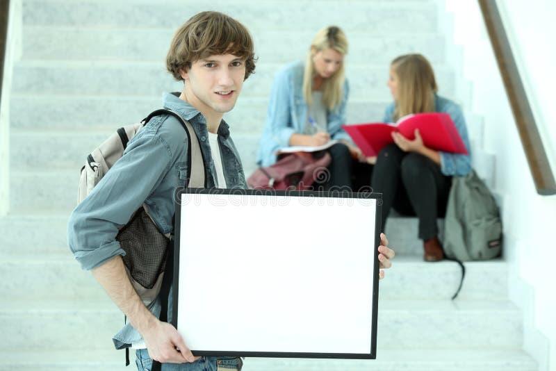 拿着委员会的大学生 库存照片