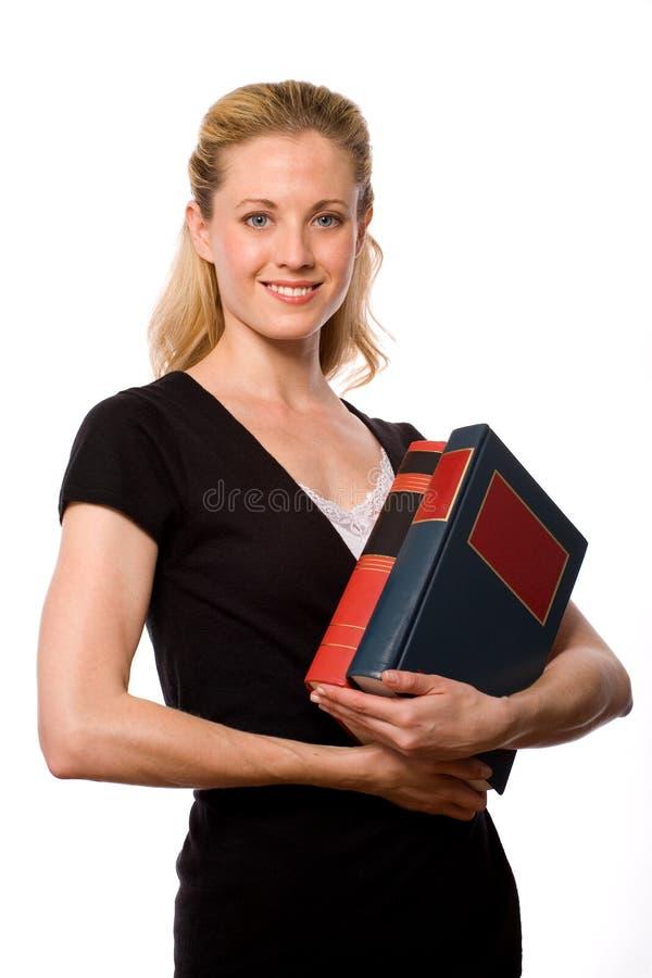 拿着学员的书 库存图片