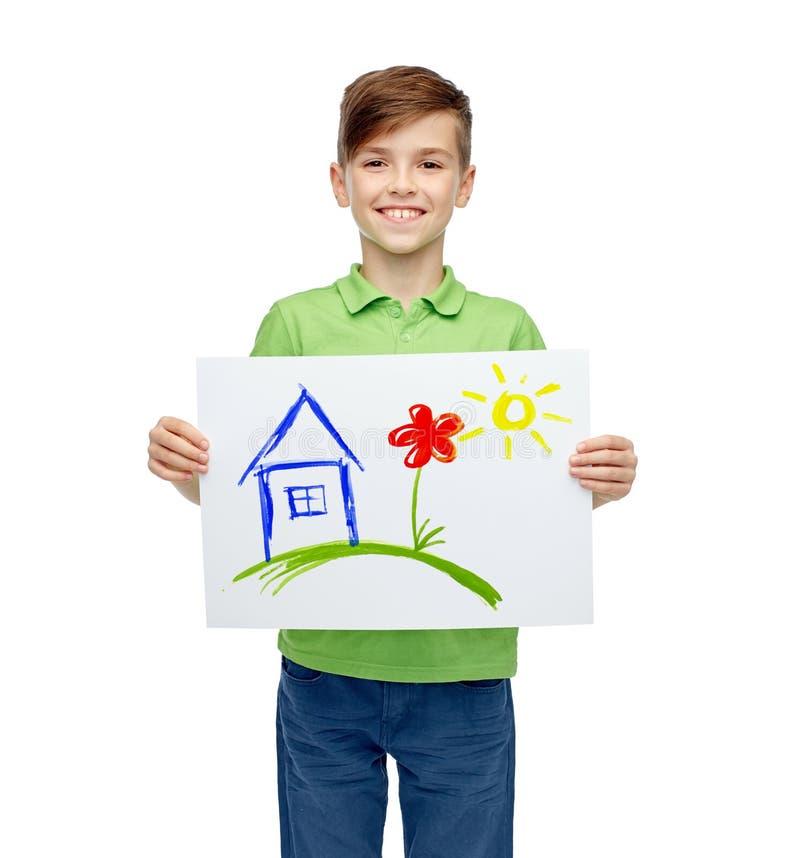 拿着家的图画或图片愉快的男孩 免版税库存照片
