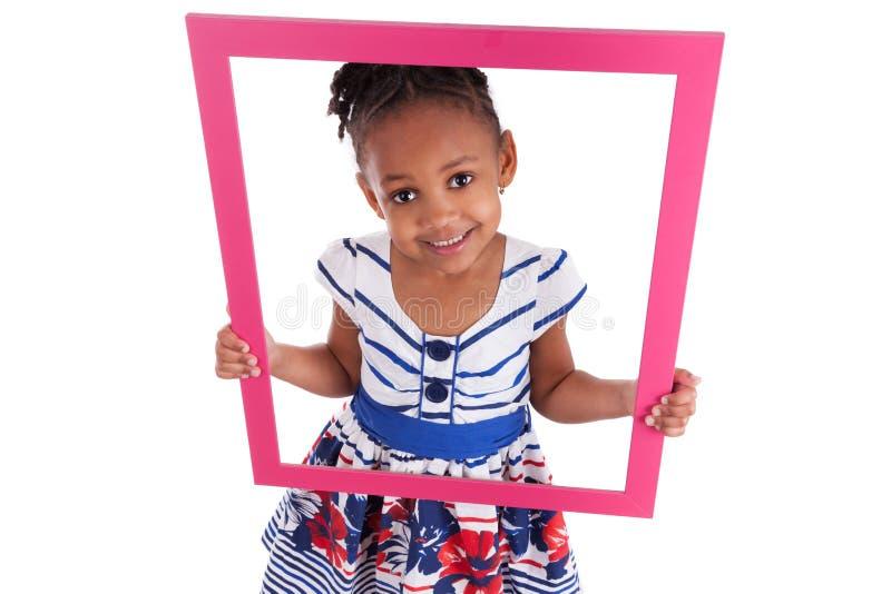 拿着少许照片的非洲框架女孩 免版税图库摄影