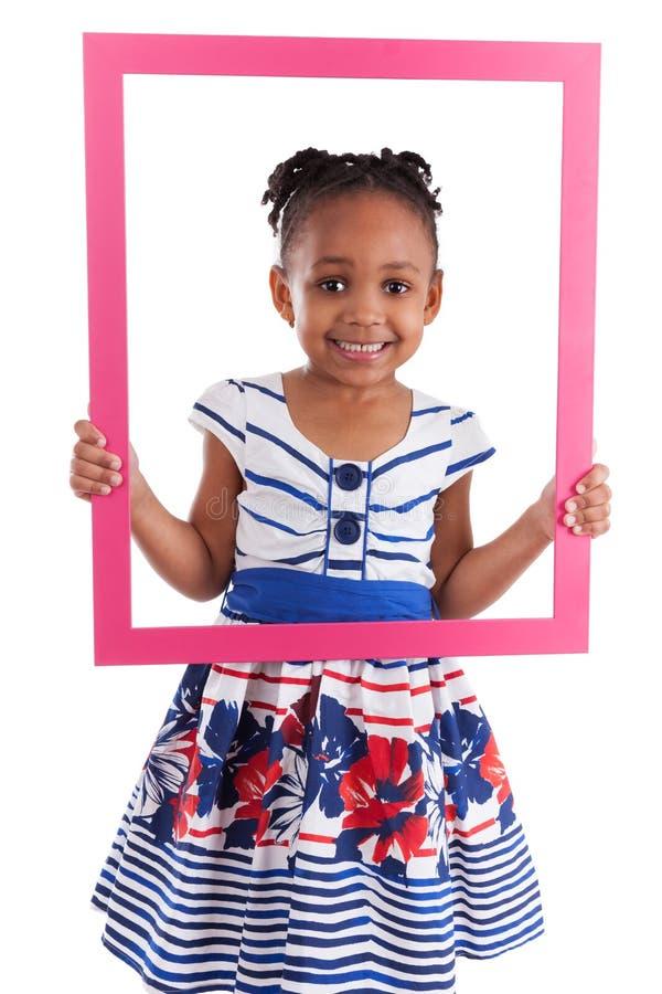 拿着少许照片的非洲框架女孩 免版税库存照片